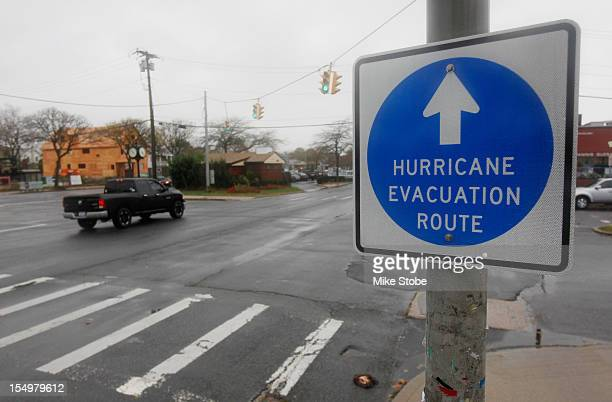 A hurricane evacuation route sign hangs on a post on October 28 2012 in Long Beach New York Hurricane Sandy which threatens 50 million people in the...