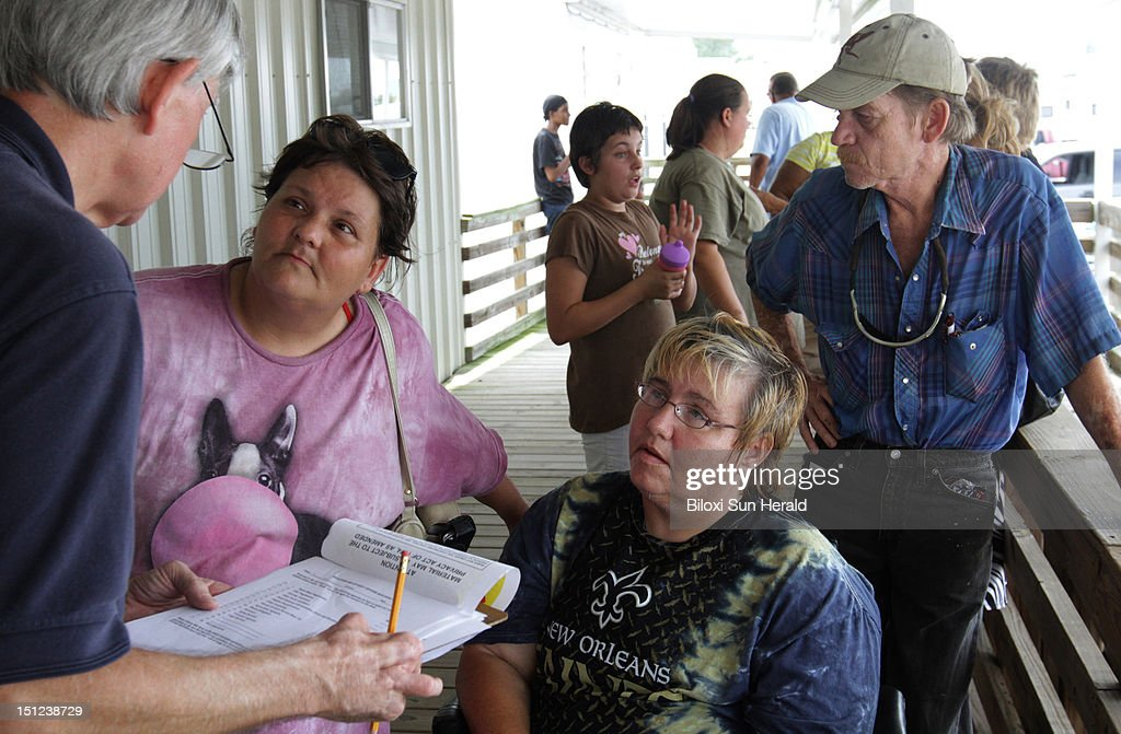 Hurricane Isaac victims Tammy Graham of Moss Point, Miss., left, and Vivian Albar of Helena, Miss., talk to Brant Ballard of FEMA at the FEMA/MEMA Disaster Recovery Center at the Jackson County Fairgrounds in Pascagoula, Mississippi, on Tuesday, September 4, 2012.