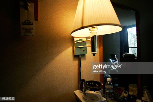 Hurricane Katrina evacuee Kathy Curry of New Orleans smokes a cigarette as she waits for news of her housing arrangement from FEMA in her room at a...