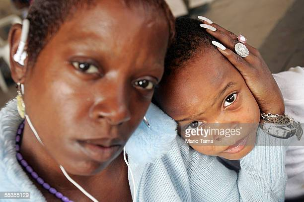 Hurricane Katrina survivors Mary Robinson and her son Charles are seen at the Houma Red Cross shelter September 10 2005 in Houma Louisiana Robinson...