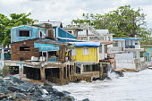 Seaside scene in Rincon, Puerto Rico after Hurricane Marie showing damage to businesses.