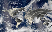 Hurricane over the world map silhouette, elements of this image furnished by NASA