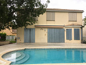 House with hurricane shutters on doors and windows, Miramar, Florida, USA