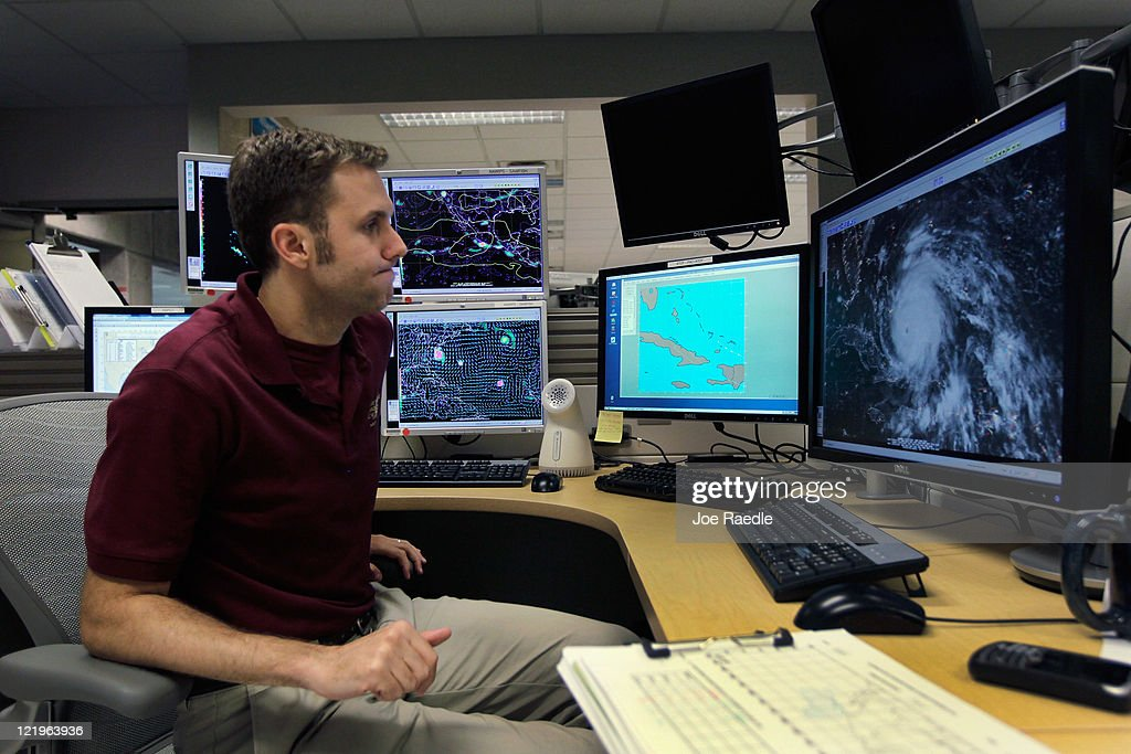 Hurricane Specialist Eric Blake works on tracking Hurricane Irene at the National Hurricane Center on August 24, 2011 in Miami, Florida. Irene is on track to move over the Bahamas as a category 3 storm and from there cooler ocean temperatures are expected to lessen the wind speeds, but it could still be a major storm as it approaches the North Carolina coast August 27.