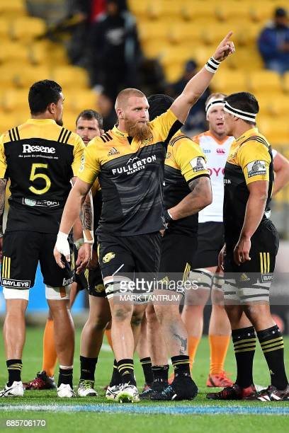 Hurricanes' Brad Shields acknowledges the crowd after turning over the ball during the Super Rugby match between New Zealand's Hurricanes and South...