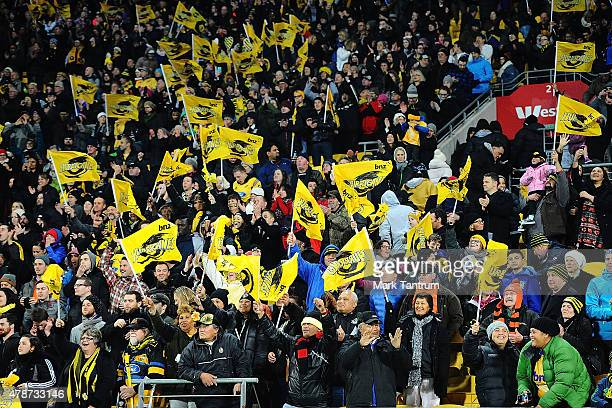 Hurricanes fans celebrate winning the Super Rugby Semi Final match between the Hurricanes and the Brumbies at Westpac Stadium on June 27 2015 in...
