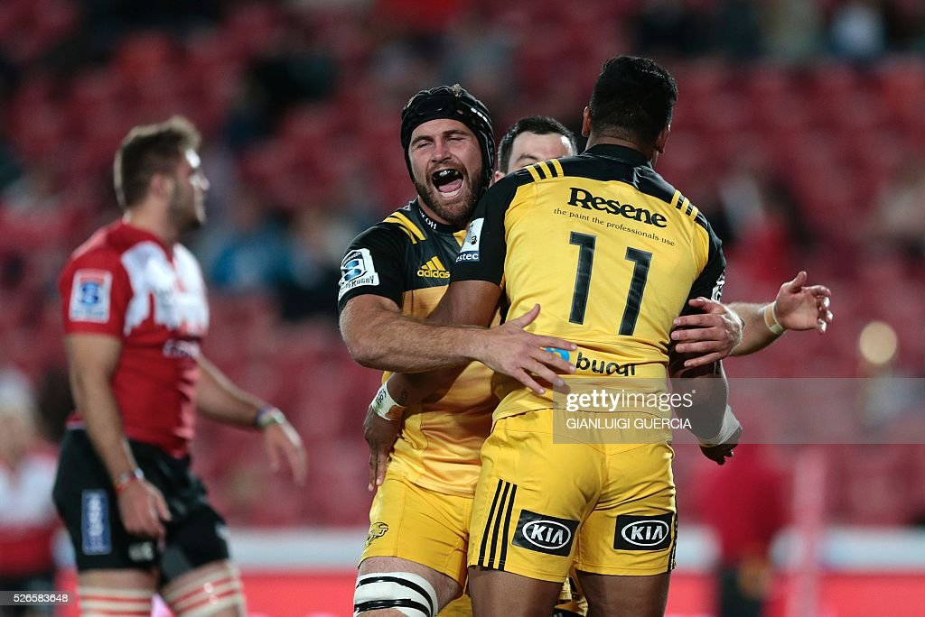 Hurricanes' New Zealand flanker Callum Gibbins (L) congratulates Hurricanes' New Zealand wing Julian Savea (R) after he scored a try during the Super Rugby clash between Lions and Hurricanes at Ellis Park rugby stadium on April 30, 2016 in Johannesburg, South Africa. / AFP / GIANLUIGI