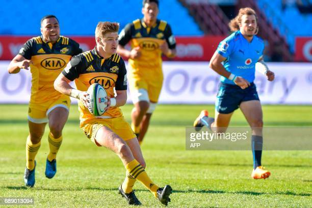 Hurricanes' New Zealander center Jordie Barrett runs with the ball during the SuperXV rugby match between Bulls and Hurricanes at the Loftus Rugby...