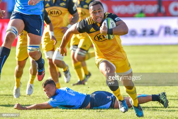 Hurricanes' New Zealander Ngani Laumape runs with the ball during the SuperXV rugby match between Bulls and Hurricanes at the Loftus Rugby Stadium on...