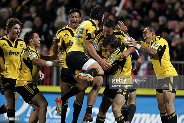 Hurricanes team mates celebrate after the round 16 Super Rugby match between the Crusaders and the Hurricanes at AMI Stadium on June 30 2012 in...