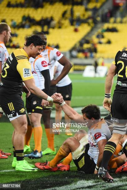 Hurricanes' Vince Aso helps Cheetahs' Henco Venter up at the end of the Super Rugby match between New Zealand's Hurricanes and South Africa's...