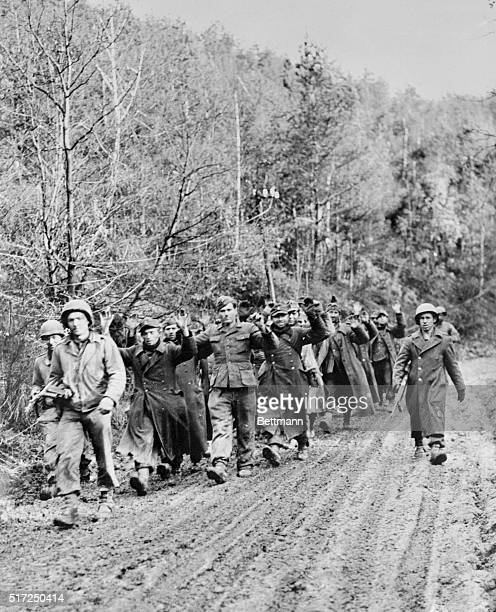 Hurtgen Forest Germany 'To The Rear March' The Newest Batch Comes In against the rugged background of the junglelike battleground of the Hurtgen...