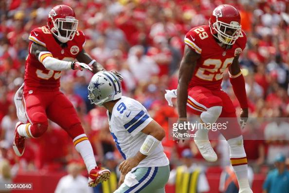 Husain Abdullah and Eric Berry of the Kansas City Chiefs attempt to knock down the pass from Tony Romo of the Dallas Cowboys in the second quarter...