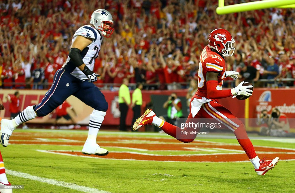 <a gi-track='captionPersonalityLinkClicked' href=/galleries/search?phrase=Husain+Abdullah&family=editorial&specificpeople=2190074 ng-click='$event.stopPropagation()'>Husain Abdullah</a> #39 of the Kansas City Chiefs scores a touchdown after an interception against the New England Patriots at Arrowhead Stadium on September 29, 2014 in Kansas City, Missouri.