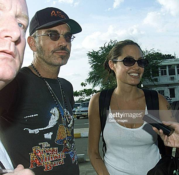 Husband and wife actors Billy Bob Thornton and Angelina Jolie talk with reporters November 7 2001 in Phnom Penh Cambodia Jolie is a goodwill...