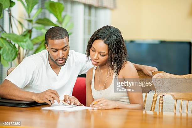 Husband and Wife Balancing Their Budget