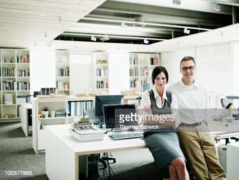 Husband and wife business owners in office : Stock Photo