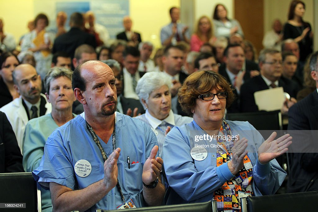 Husband and wife Charles and Carol Hurd applaud a speaker at a public hearing on Quincy Medical Center's proposal to bring back maternity services.