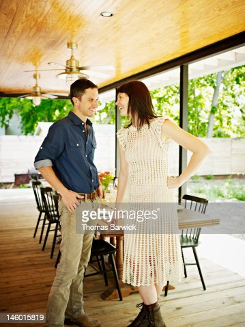 Husband and wife couple standing on porch : Stock Photo