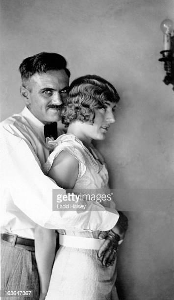 husband and wife embrace - 1930
