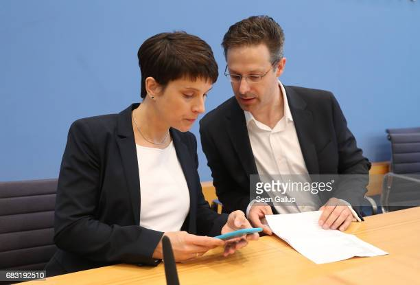 Husband and wife Frauke Petry and Marcus Pretzell who are leading members of the populist Alternative for Germany political party arrive to speak to...