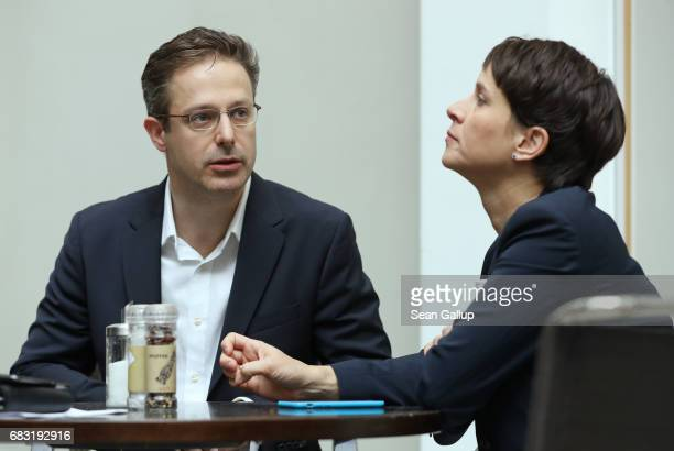 Husband and wife Frauke Petry and Marcus Pretzell who are leading members of the populist Alternative for Germany political party prepare to speak to...