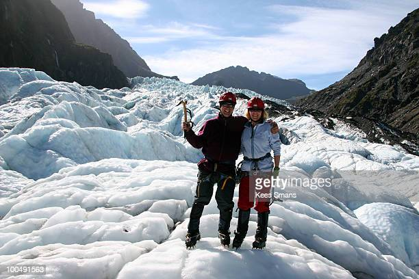 Husband and wife ice climbing on Fox Glacier NZ