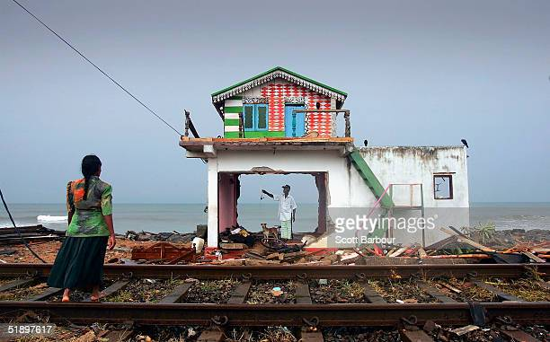 A husband and wife inspect the remains of their home on the coast of the Ratmalana district after the massive tsunami wave swept across coastal Sri...