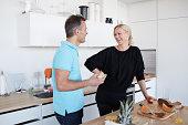 Husband and wife making healthy breakfast
