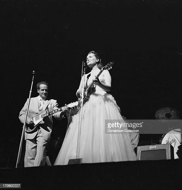 Husband and wife musical team Les Paul and Mary Ford perform onstage with Les Paul electric guitars at the New York Paramount on June 19 1952 in New...