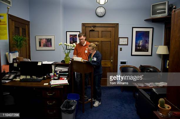 Husband and wife Nicholas and Melanie Barrett leave a message in the guest book in the office of Rep Gabrielle Giffords DAriz in Longworth Building...