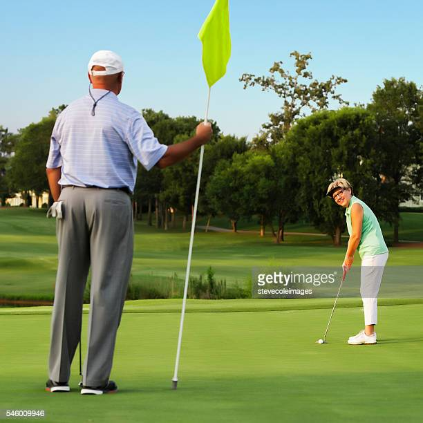 Husband and WIfe Playing Golf