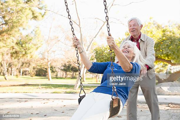Husband and wife playing swing, Hahn Park, Los Angeles, California, USA