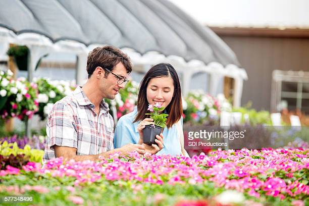 Husband and wife shop for plants at nursery