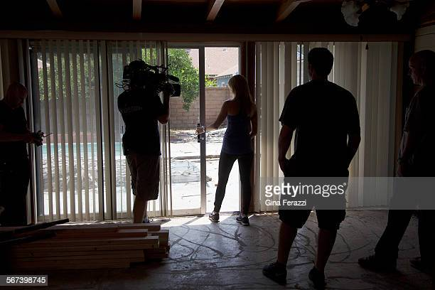 Husband and wife team Christinacenter and Tarek El Moussa discuss replacing the screen door off the living room while filming an episode of 'Flip or...