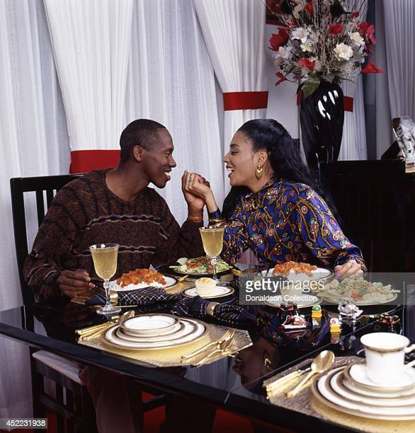 Husband and wife track and field athletes Florence Griffith Joyner and her husband Al Joyner pose for a portrait over dinner at home for a portrait...