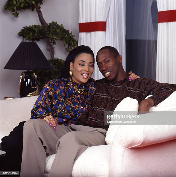 Husband and wife track and field athletes Florence Griffith Joyner and her husband Al Joyner pose for a portrait at home for a portrait session in...