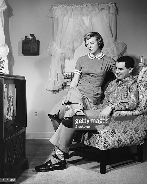 Husband and wife watching television