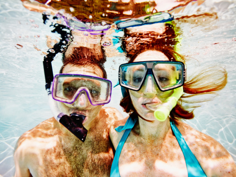 Husband and wife wearing snorkel masks