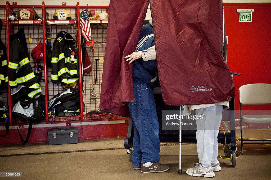 Husband and wife William and Ellen Repsher, married 61 years, help each other vote at the Point Pleasant Fire House on November 6, 2012 in Point Pleasant, New Jersey. As the New Jersey coastline continues to recover from Superstorm Sandy, numerous polling stations have had to be merged and relocated due to storm damage and power outages.