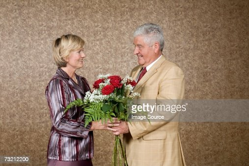 Husband and wife with flowers : Stock Photo