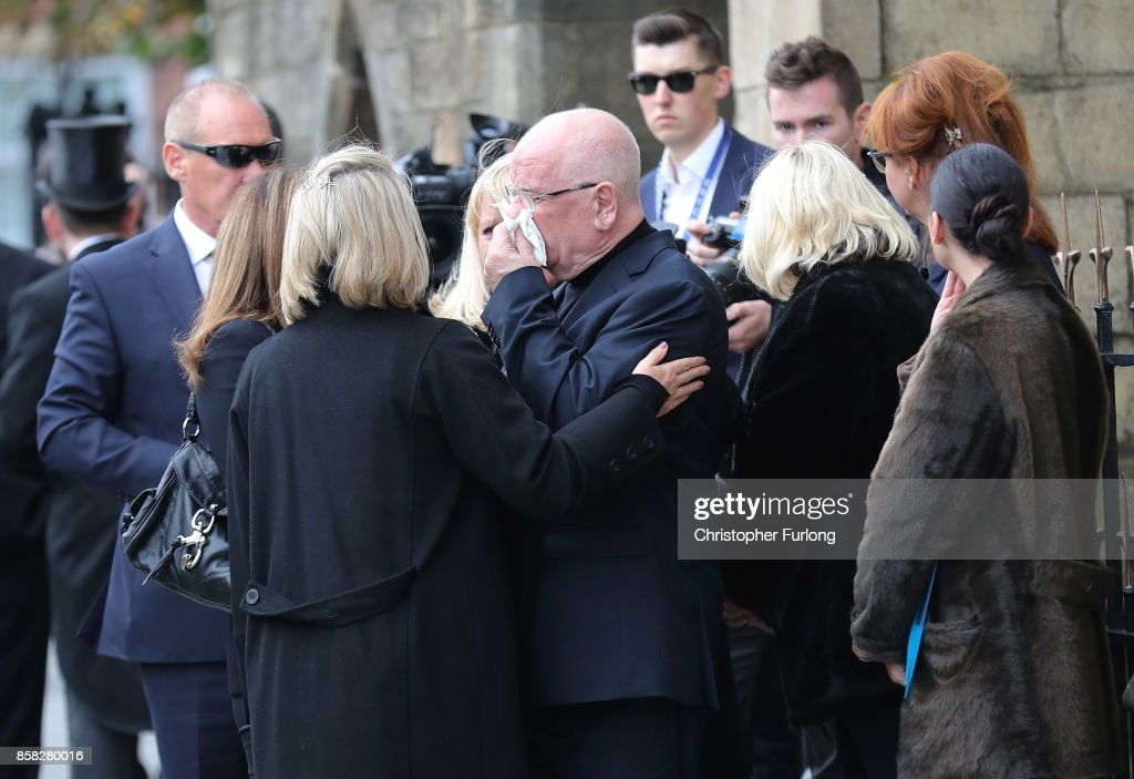 Husband Donald Ibbetson (C) is consoled outside of Salford Cathedral on October 6, 2017 in Salford, England. Actress Liz Dawn who died aged 77, played Vera Duckworth in Coronation Street for 34 years. She was diagnosed with lung disease emphysema and was written out of the show in 2008 at her own request.