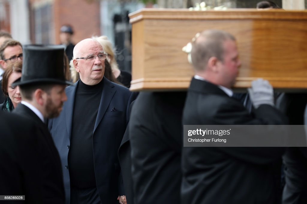 Husband Donald Ibbetson (L) looks on as the coffin of Liz Dawn is carried into Salford Cathedral on October 6, 2017 in Salford, England. Actress Liz Dawn who died aged 77, played Vera Duckworth in Coronation Street for 34 years. She was diagnosed with lung disease emphysema and was written out of the show in 2008 at her own request.