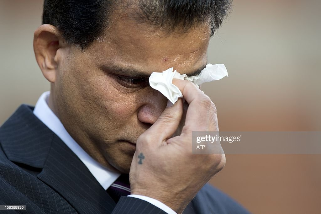 Husband of late nurse Jacintha Saldanha, Benedict Barboza wipes his eyes as he addresses media representatives outside Westminster Cathedral in central London following of a service of Thanksgiving for the life of Jacintha Saldanha on December 15, 2012. The children of a nurse found hanged after she was duped by a hoax phone call to the hospital treating Prince William's wife Catherine told a mass in her memory her death left 'an unfillable void'. Indian-born Jacintha Saldanha, 46, apparently killed herself in nurses' accommodation at King Edward VII's Hospital in London last week.
