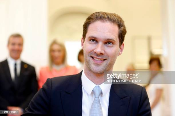 Husband of Luxembourg's prime minister Gauthier Destenay poses before a diner at the Royal castle in Laken/Laeken on May 25 in Brussels / AFP PHOTO /...