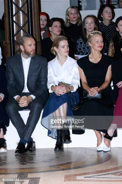 Husband of Stella Alasdhair Willis Natalia Vodianova and Pamela Anderson attend the Stella McCartney show as part of the Paris Fashion Week...