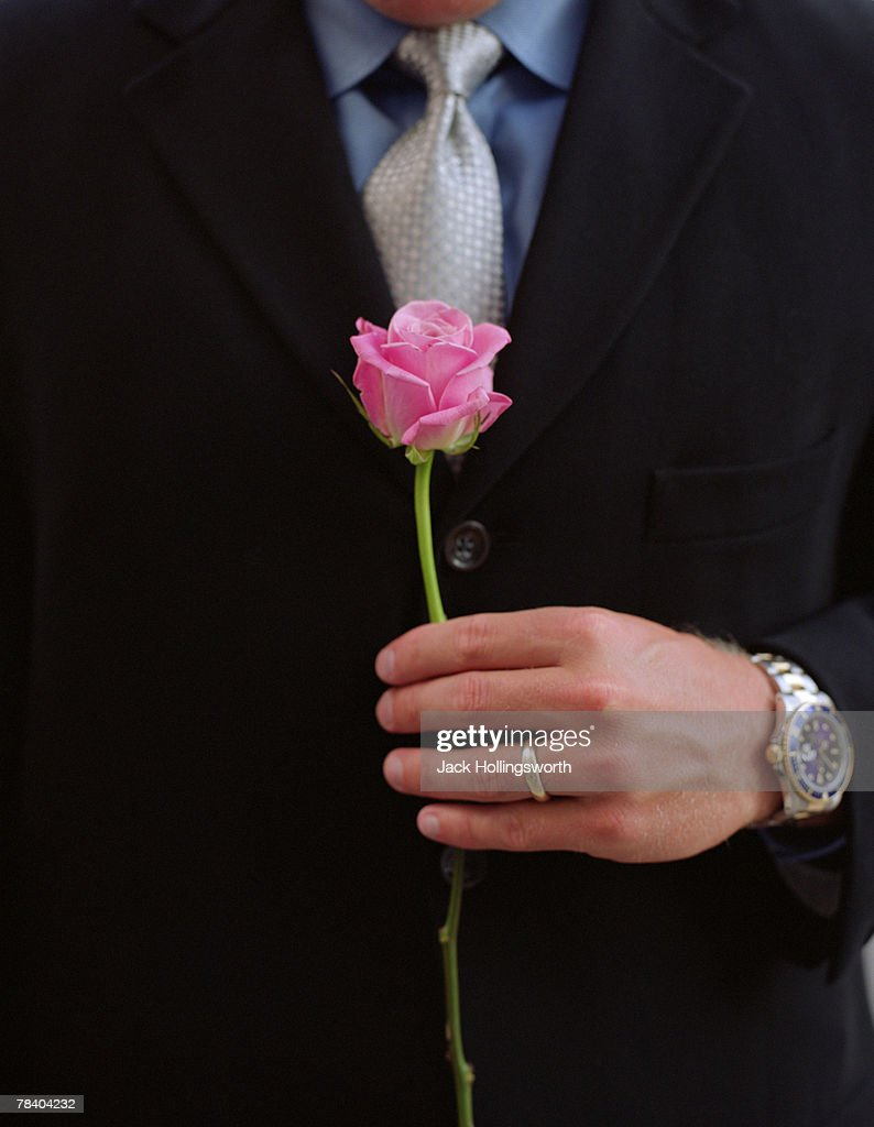 Husband with pink rose