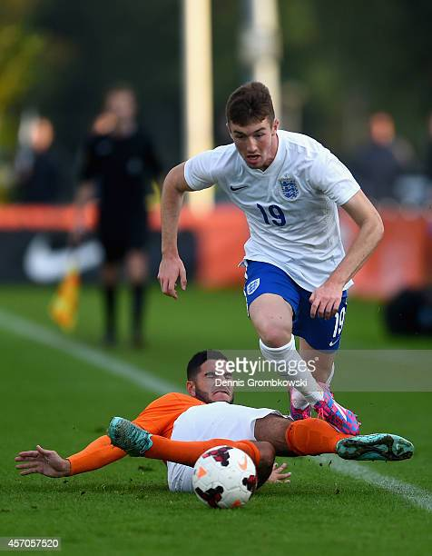 Huseyin Dogan of Netherlands challenges Chris Long of England during the International Under 20 Tournament match between U20 Netherlands and U20...