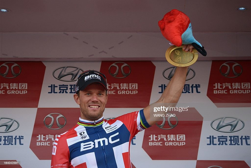 Hushovd Thor of the BMC Racing team gestures on the podium after winning the first stage of the 2013 Tour of Beijing cycling race on October 11, 2013.