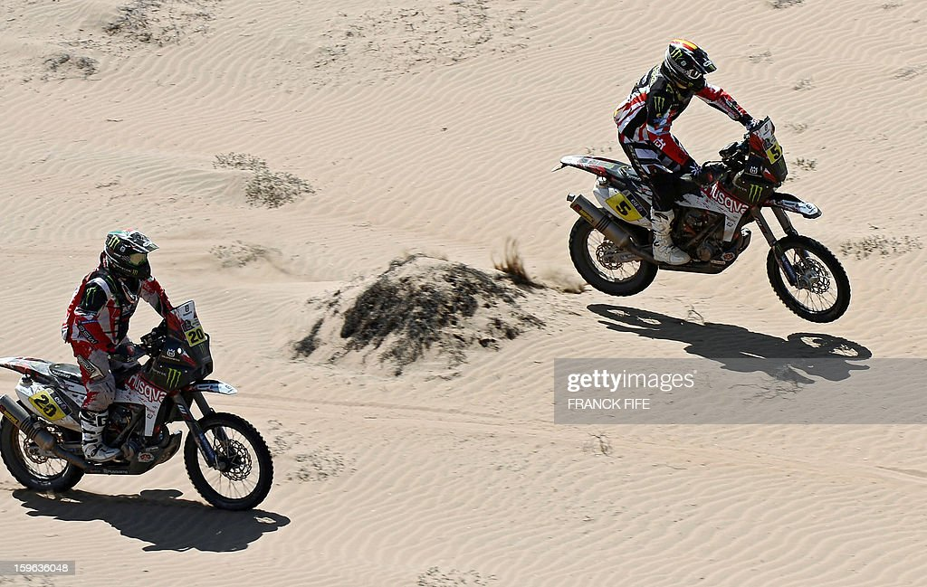 Husqvarna's Joan Barreda Bort (R) of Spain and Paulo Goncalves of Portugal compete during the Stage 12 of the Dakar 2013 between Fiambala, Argentina and Copiapo, Chile, on January 17, 2013. The rally takes place in Peru, Argentina and Chile between January 5 and 20. AFP PHOTO / FRANCK FIFE